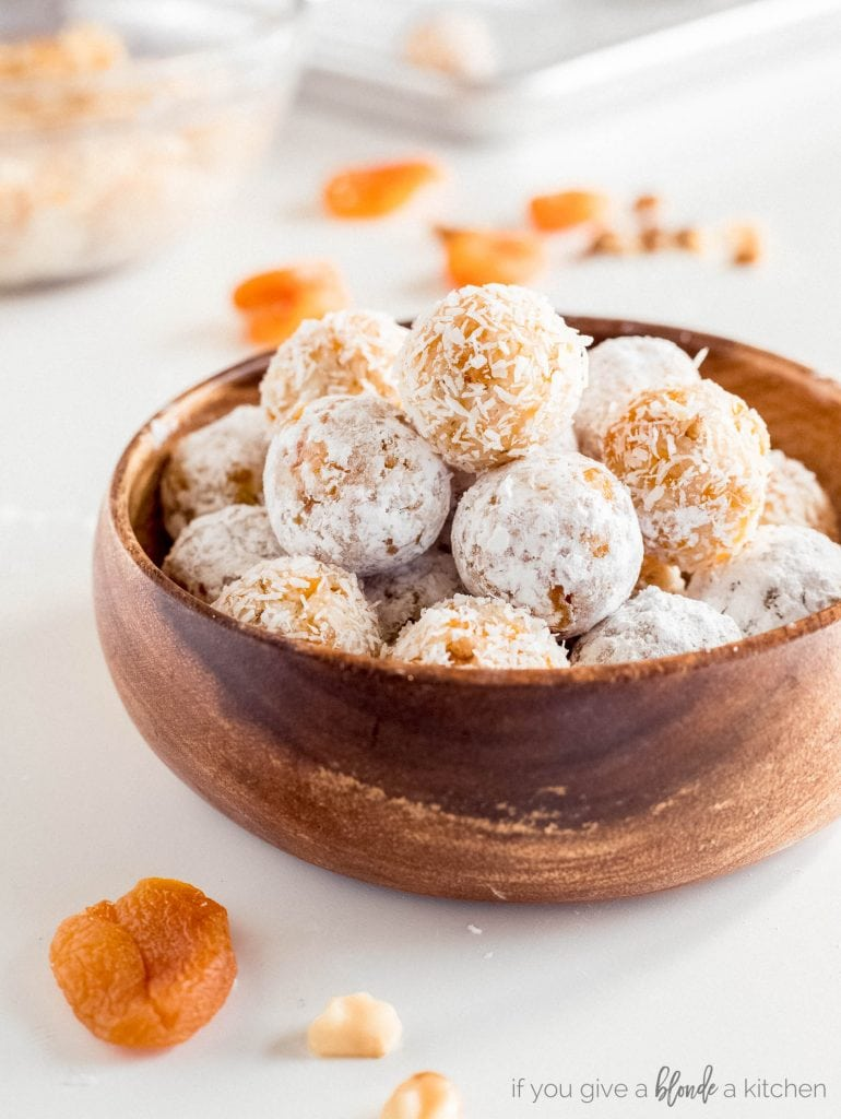 coconut apricot balls in wooden bowl