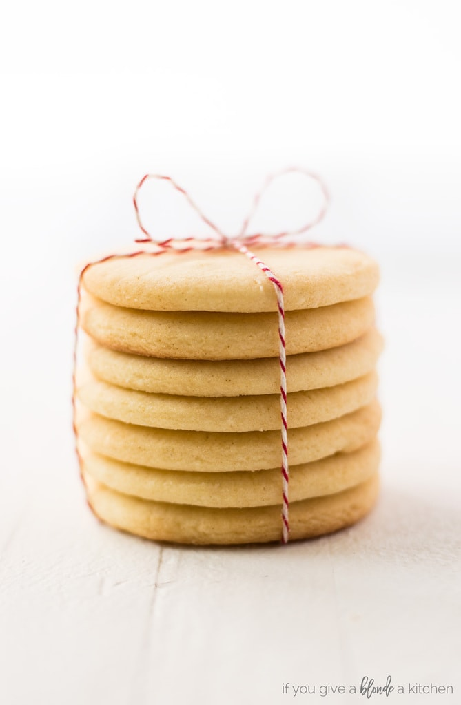 Easy cut out sugar cookie recipe stack of cookies tied in red baker's twine