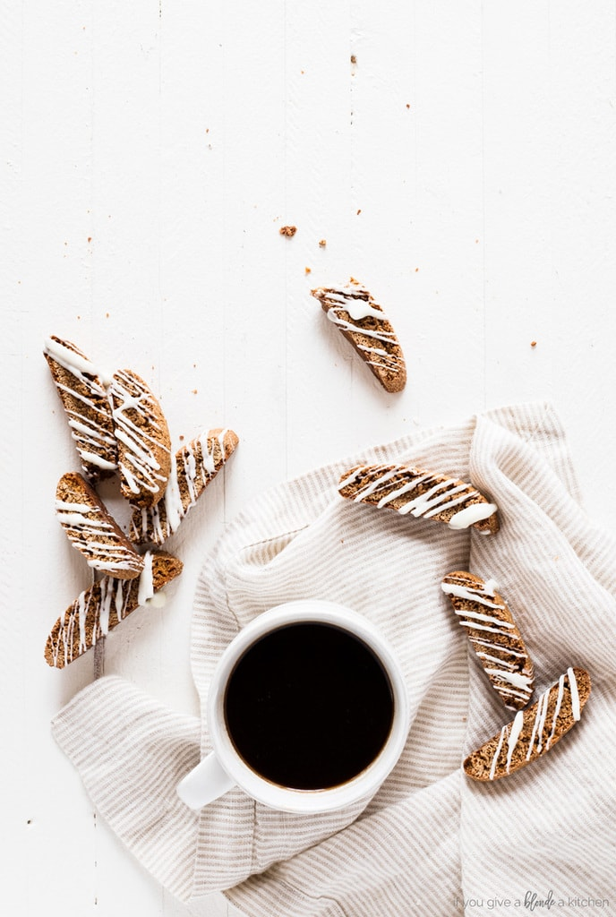 Gingerbread biscotti recipe overhead shot with black coffee and striped tea towel