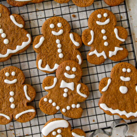 iced gingerbread man cookies on wire cooling rack
