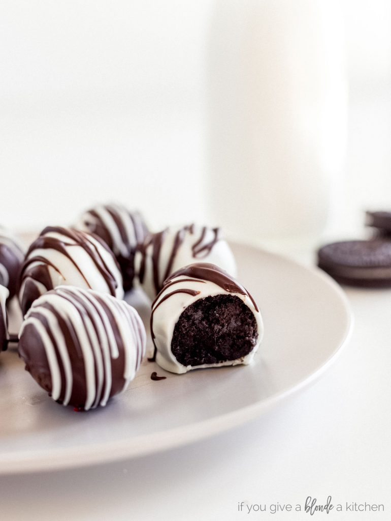 white chocolate oreo truffles and dark chocolate oreo truffles with drizzle on grey plate