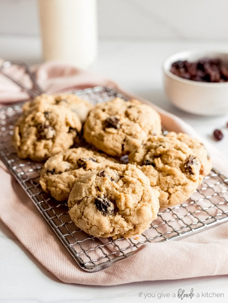 oatmeal raisin cookies on wire cooling rack and pink kitchen cloth