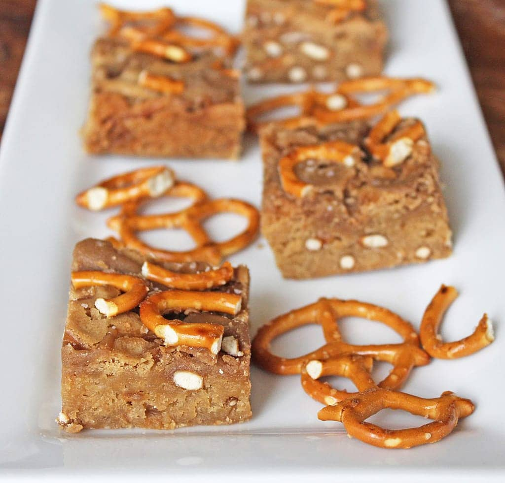 Salted Caramel Blondies are made with caramel sauce and crushed pretzels to provide a delightfully sweet and salty dessert! | Recipe by @haleydwilliams