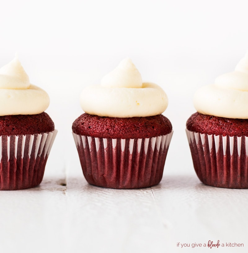 mini red velvet cupcakes close up with cream cheese frosting