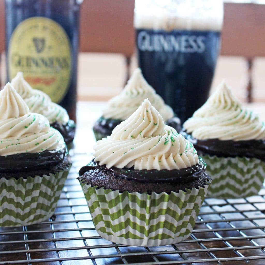 Irish Car Bomb Cupcakes are made of Guinness cake, Jameson Whiskey chocolate ganache and Bailey's buttercream frosting—the perfect St. Patrick's Day treat! | Recipe by @haleydwilliams