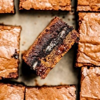 side of cookie dough oreo brownie in pan of brownie squares