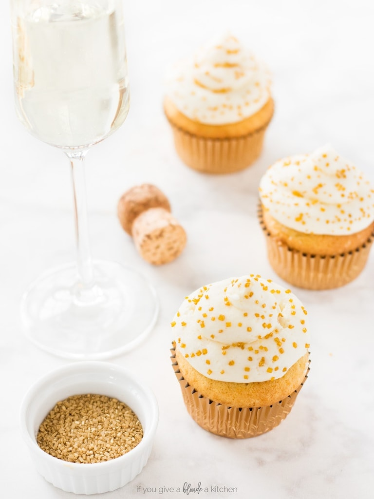 Champagne cupcakes recipe is perfect for New Year's Eve. Vanilla cupcakes and buttercream frosting are both spiked with bubbly for a festive way to ring in the new year! | www.ifyougiveablondeakitchen.com