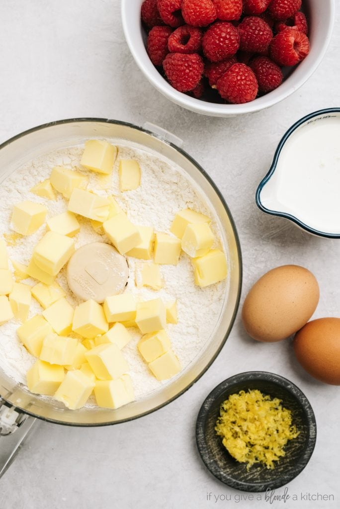 cold butter pieces and flour in bowl of food processor. Eggs, lemon zest and raspberries