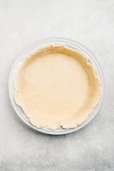 homemade pie crust in ceramic pie dish