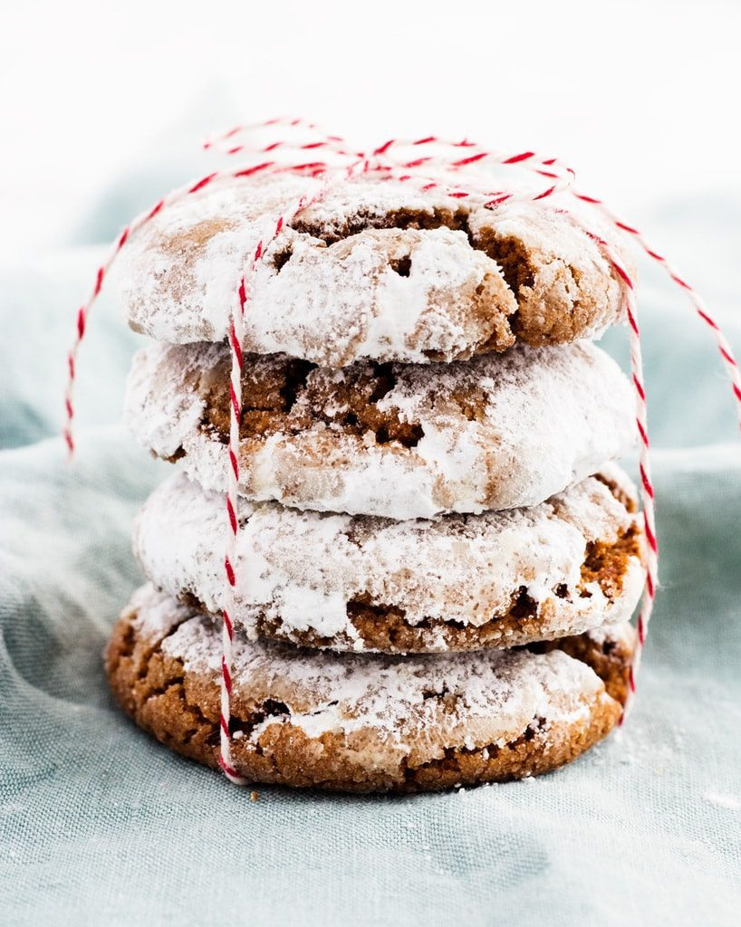 stack of gingerbread crinkle cookies in red twine