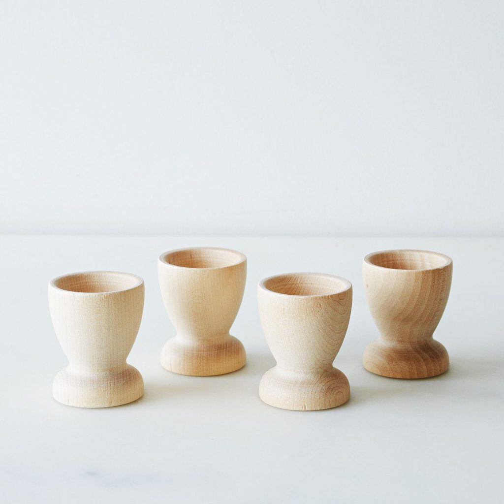 Easter Entertaining Essentials: Wooden egg cups, perfect for displaying decorated Easter eggs. | @haleydwilliams