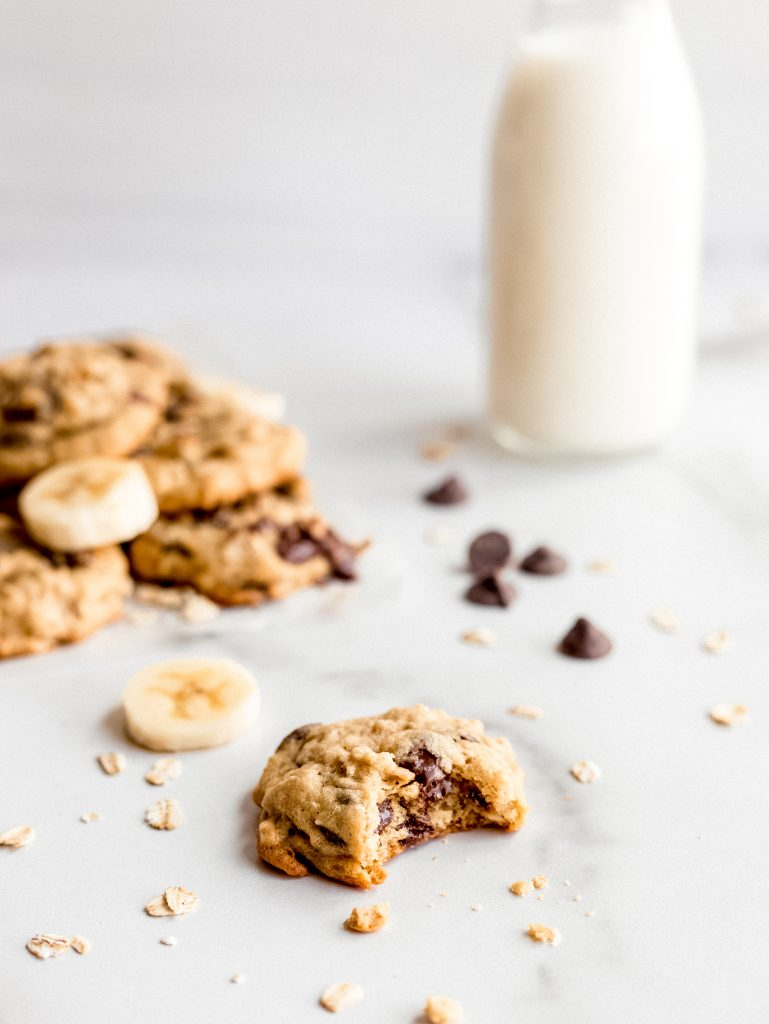 banana oatmeal cookie with bite and melted chocolate chips