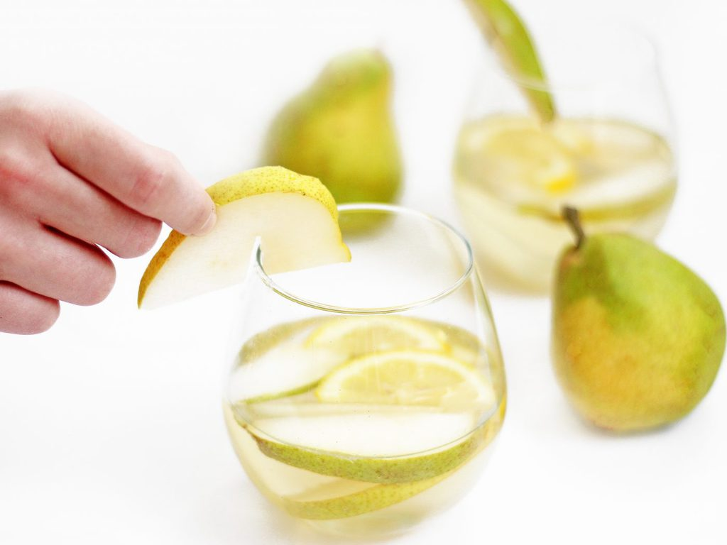 Citrus Pear White Wine Sangria uses super juicy pears, fresh lemon wedges and a bottle of pinot gris. This easy recipe is a must for summer! | www.ifyougiveablondeakitchen.com