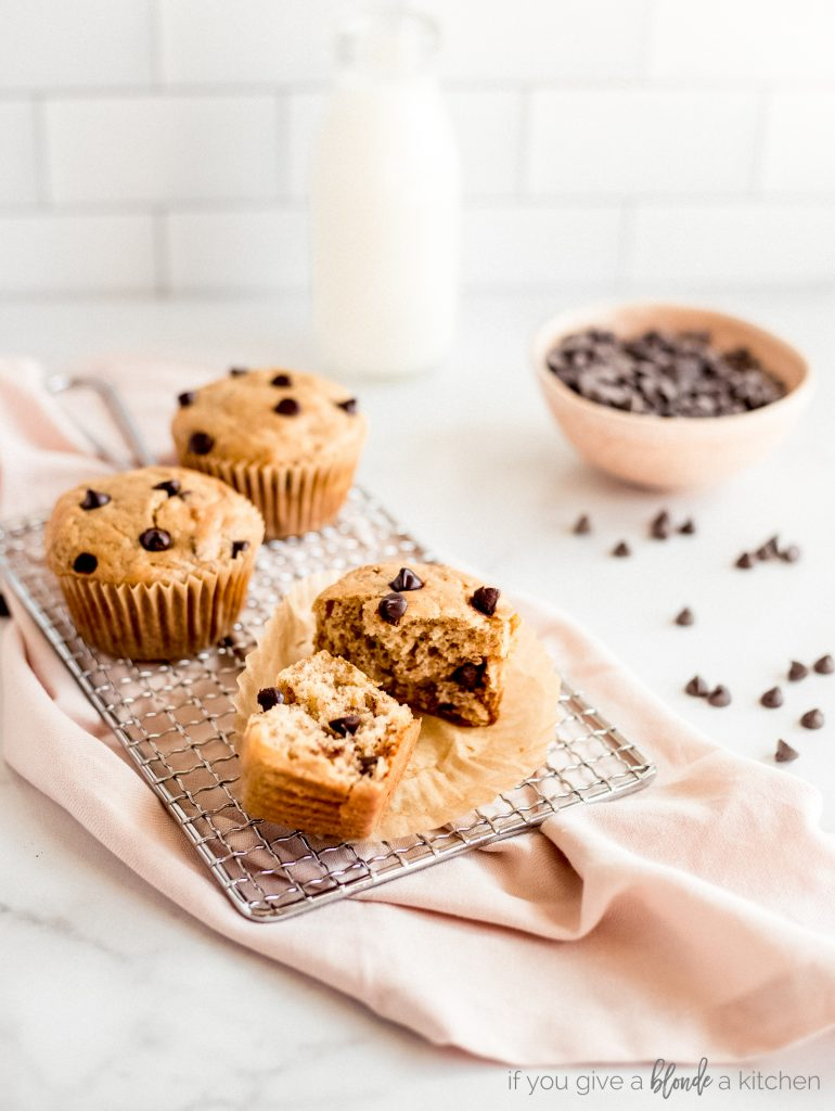 banana chocolate chip muffin halves on wire cooling rack