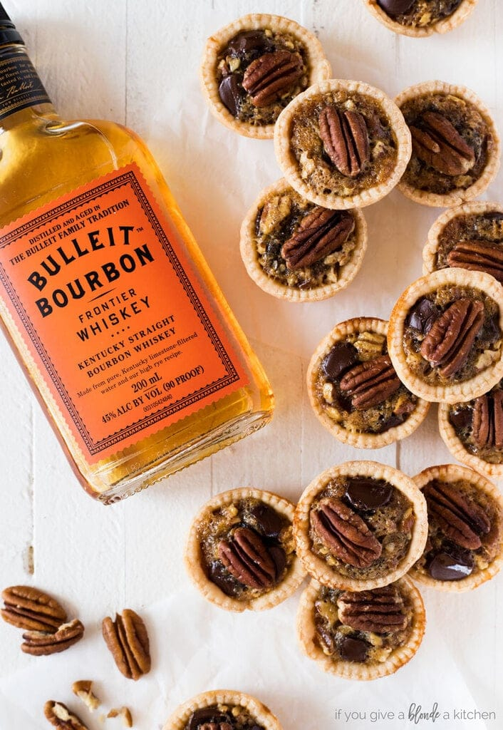 Mini Kentucky derby pies with bottle of Bulleit Bourbon