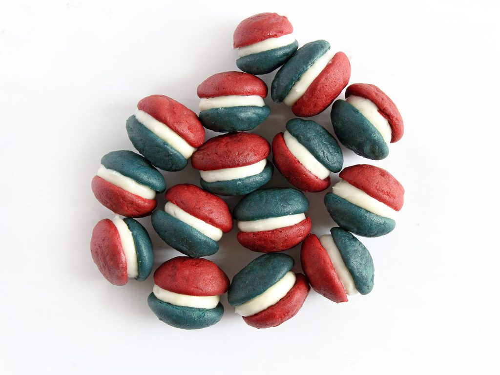 So creative! Mini patriotic whoopie pies are made with blue velvet and red velvet whoopie pies and cream cheese frosting for filling. Perfect for the Fourth of July or Memorial Day! | Recipe at www.ifyougiveablondeakitchen.com