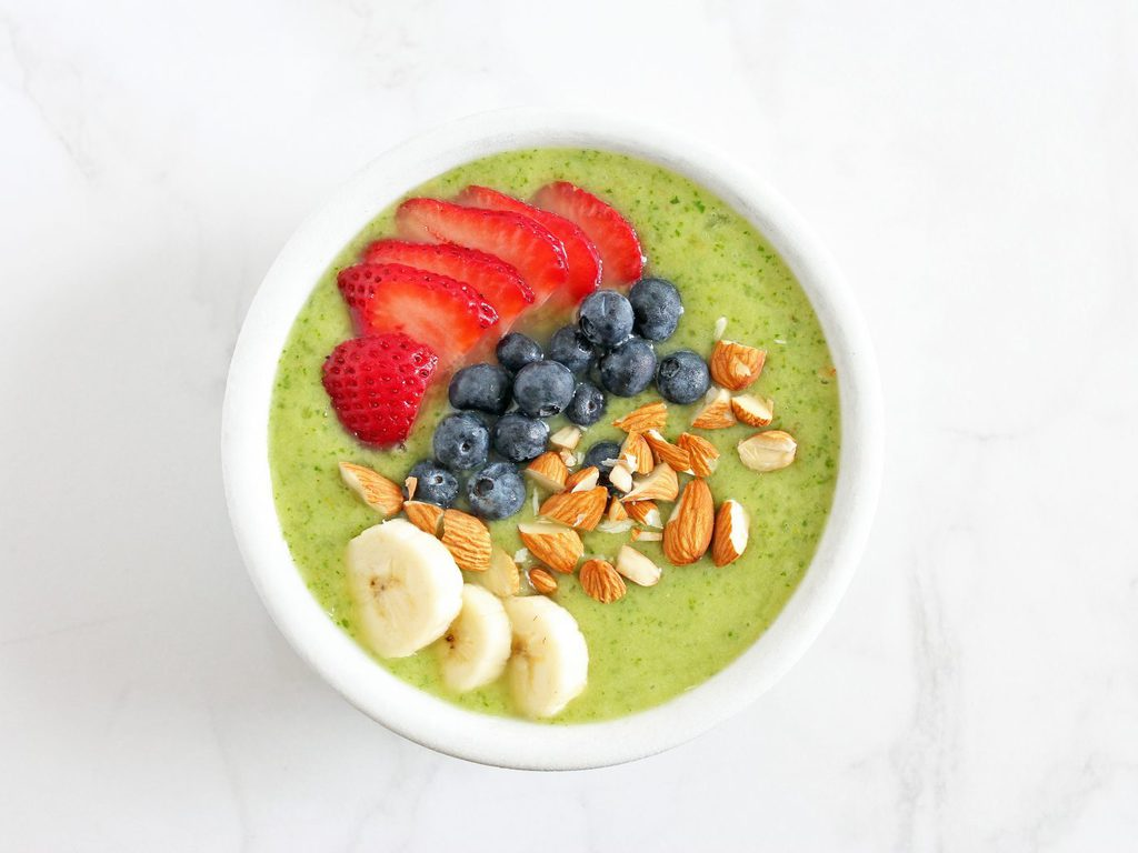 This fruity green smoothie bowl sneaks in vegetables into your breakfast without you tasting them. | Recipe on www.ifyougiveablondeakitchen.com