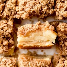 apple bars with crumble topping; one bar turned on its side to show apple layers
