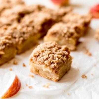 easy apple crisp bars square on parchment paper with apple slice