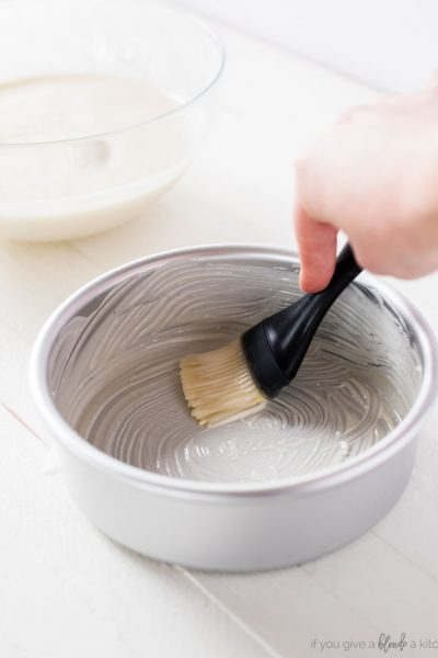 magic cake pan release paste. silver round cake pan with silicone pastry brush. homemade paste brushing inside of pan