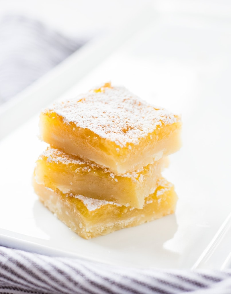 This recipe for perfect lemon bars is, well, perfect! They are gooey, citrusy and delicious! | www.ifyougiveablondeakitchen.com