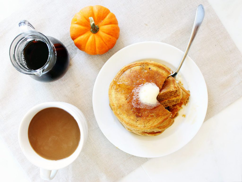 Fluffy pumpkin pancakes taste like clouds of pumpkin pie! | www.ifyougiveablondeakitchen.com