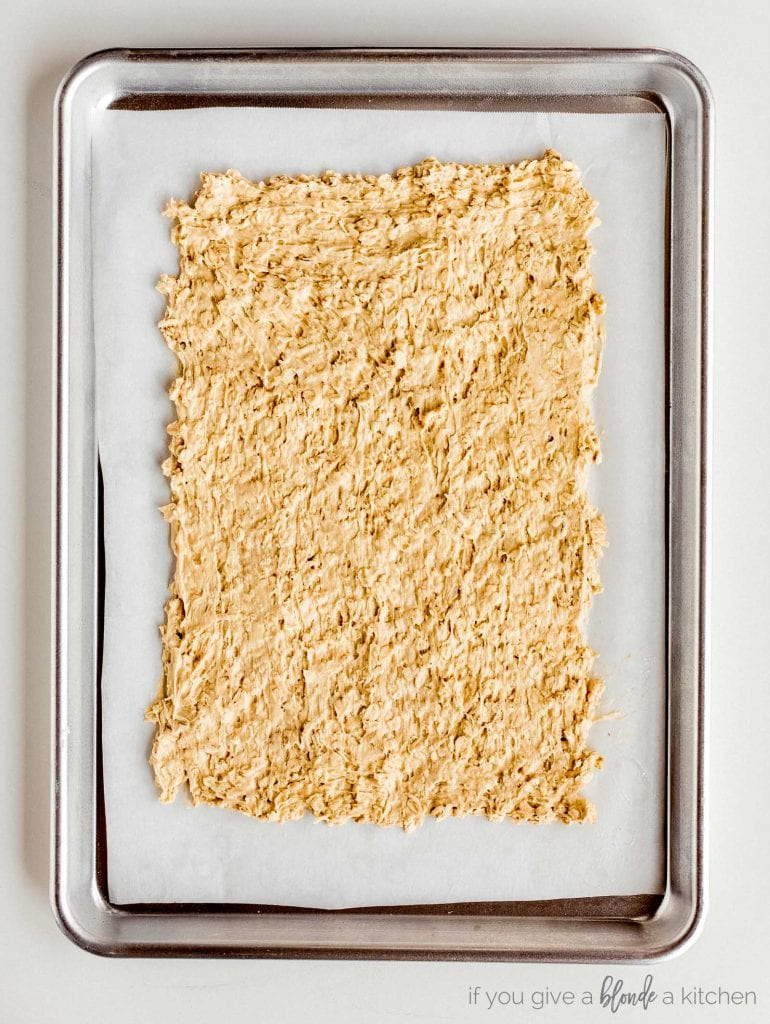 uncooked oatmeal cookie dough on baking sheet