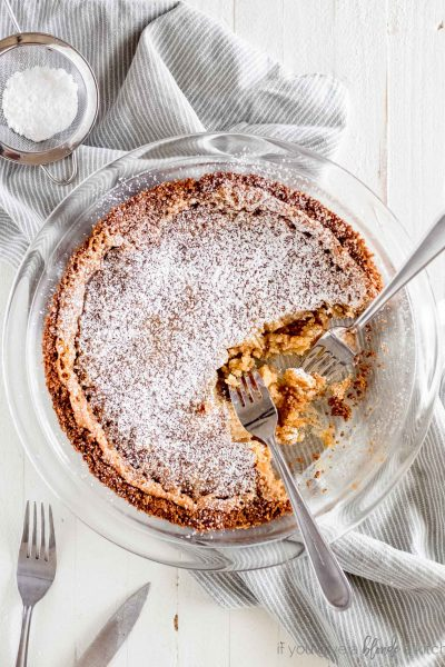 milk bar crack pie in pie dish with forks taking bites