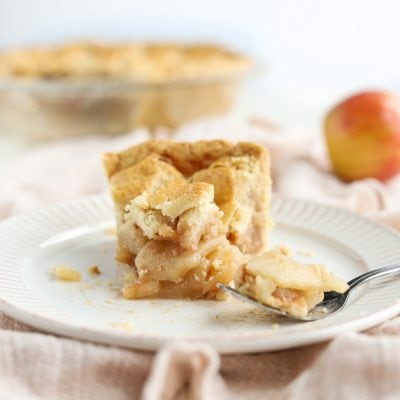 slice of apple pie with fork and plate