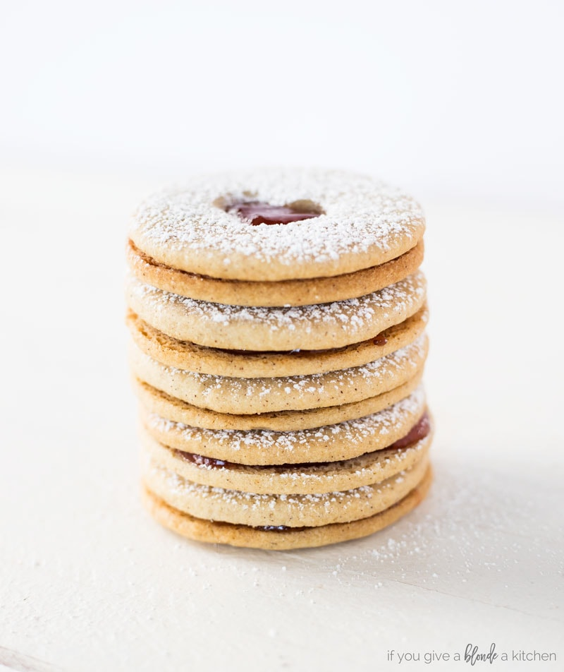 Linzer cookies stacked on top of each other. Almond cookies with jam sandwiched in the center