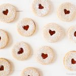 holiday linzer cookies valentines day heart with confectioners' sugar