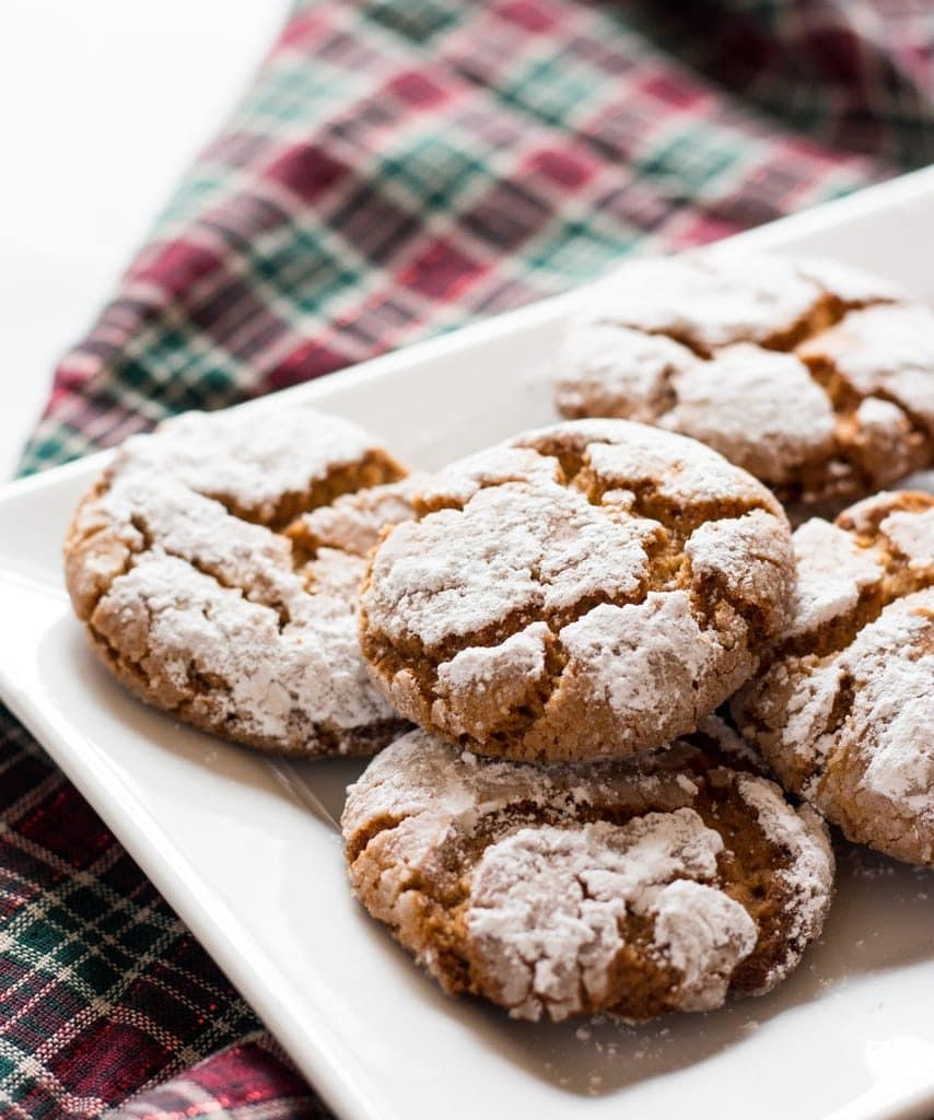peanut butter crinkle cookies on white plate with plaid fabric