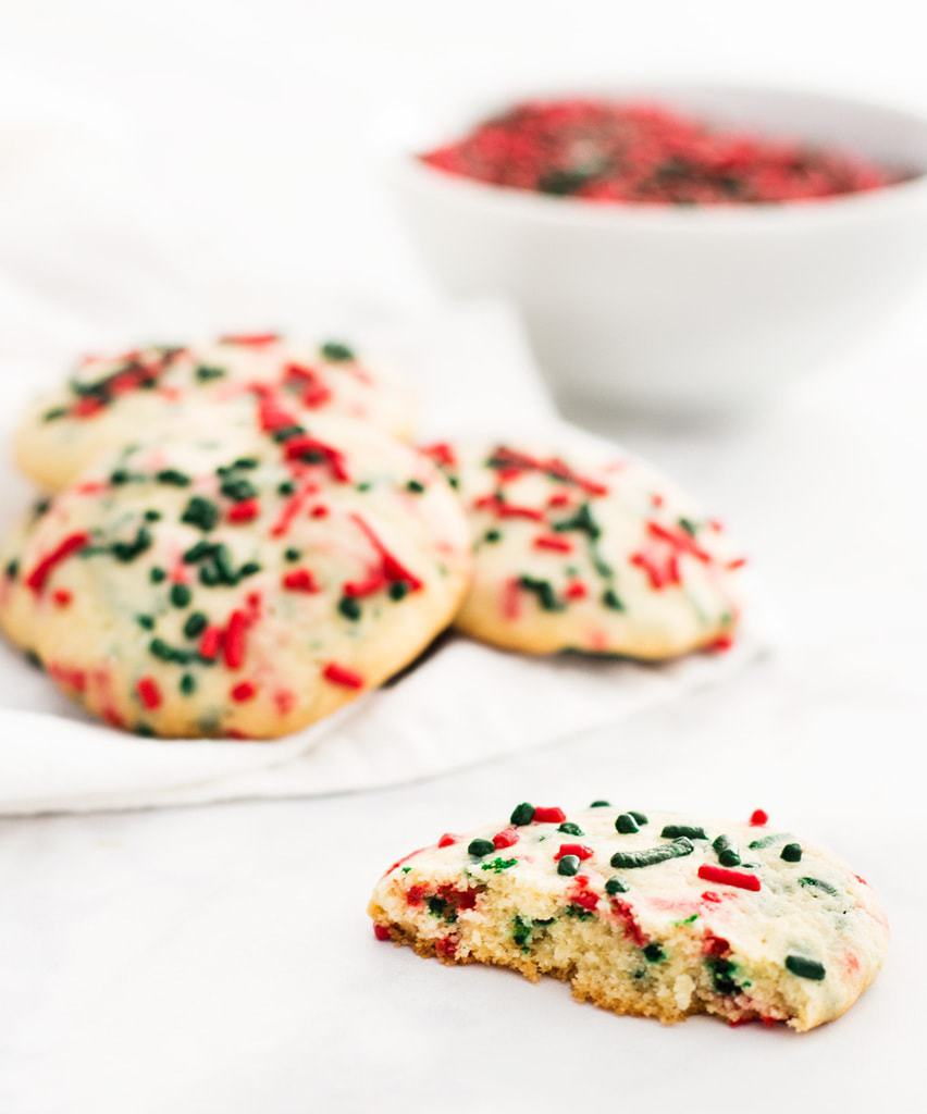 Christmas sprinkle sugar cookies are chewy and sweet. Make the dough ahead of time and freeze for up to a month. | www.ifyougiveablondeakitchen.com