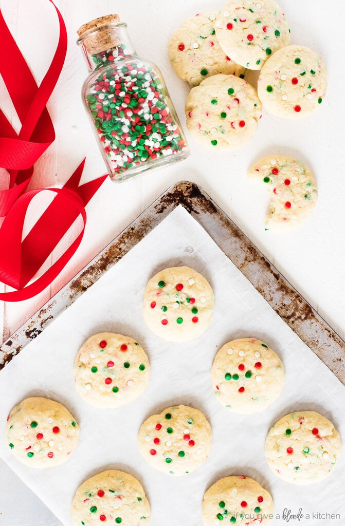 Sprinkle Sugar Cookies Christmas on baking sheet with red ribbon