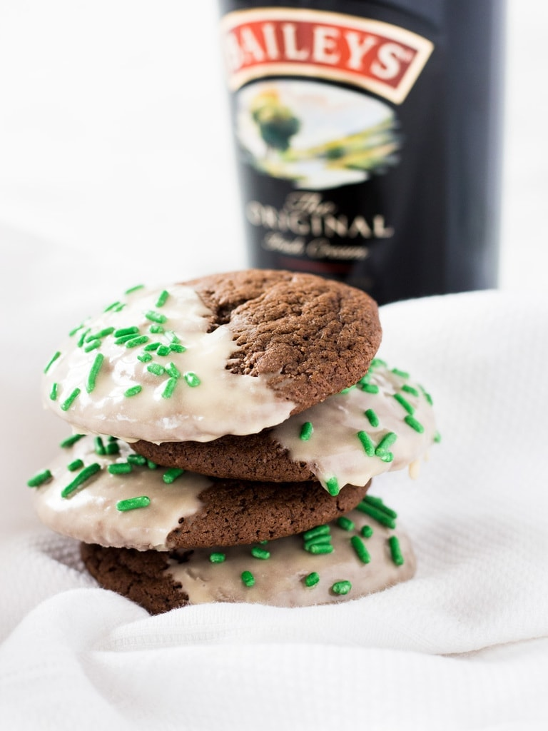 Chocolate Baileys cookie with icing are a boozy dessert perfect for St. Patrick's Day! | www.ifyougiveablondeakitchen.com