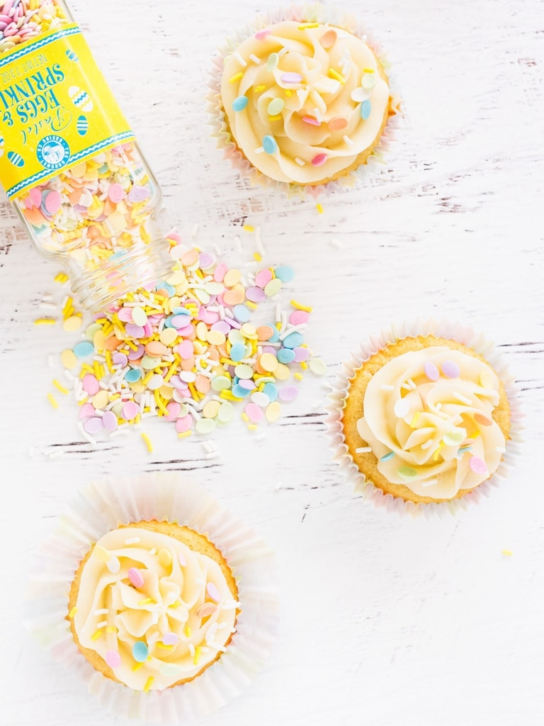 This recipe makes the best vanilla cupcakes! They're moist, full of vanilla flavor and topped with fluffy buttercream frosting. | www.ifyougiveablondeakitchen.com