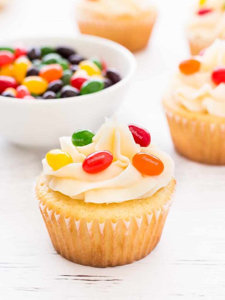 Jelly bean cupcakes are simple vanilla cupcakes decorated with jelly beans inside and out! Perfect for Easter. | www.ifyougiveablondeakitchen.com
