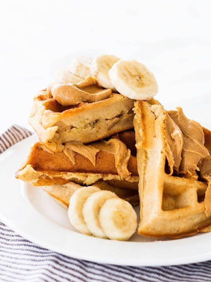 Banana peanut butter waffles are an insanely good breakfast choice. The recipe makes crisp and fluffy waffles! | www.ifyougiveablondeakitchen.com
