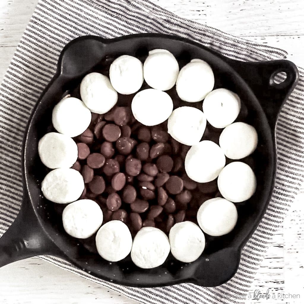 marshmallows layered on top of chocolate chips