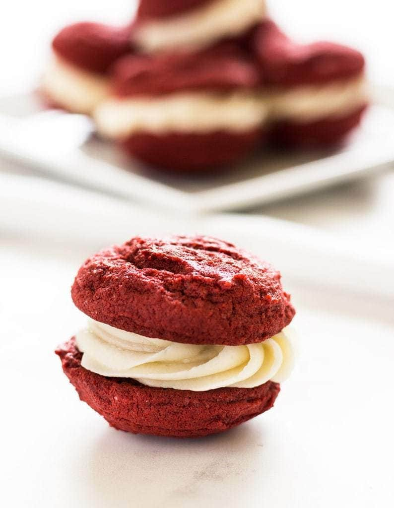 Red velvet sandwich cookies is like red velvet cake in cookie form! The cream cheese frosting is the best filling. | www.ifyougiveablondeakitchen.com