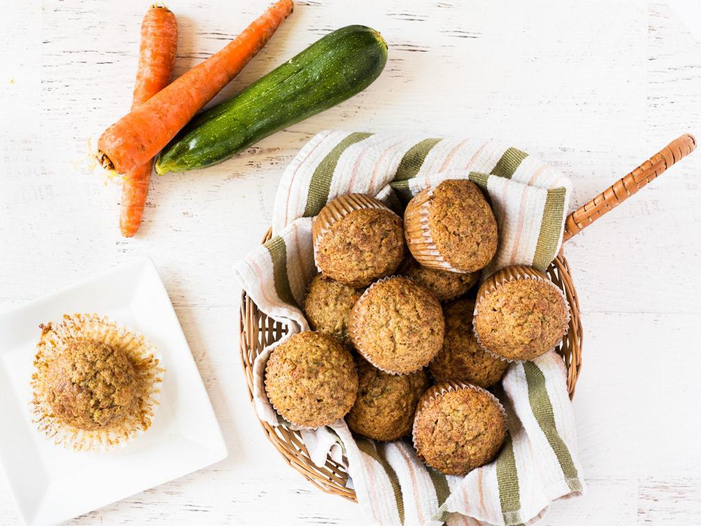 Get your serving of vegetables in muffin form! This recipe for carrot zucchini muffins is so good. | www.ifyougiveablondeakitchen.com