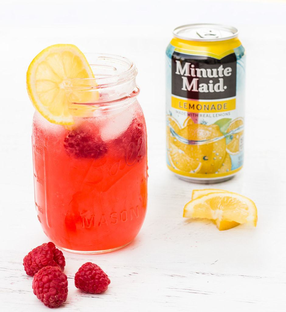 This raspberry lemonade recipe is very easy to make. Raspberry pureé is added to Minute Maid Lemonade for a fruity twist! | www.ifyougiveablondeakitchen.com