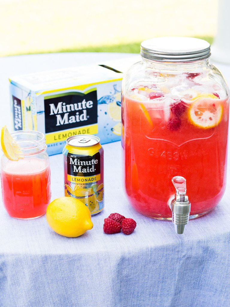 Freshen up your lemonade with raspberries! This raspberry lemonade recipe uses Minute Maid Lemonade and homemade raspberry pureé to make a refreshing summer drink. | www.ifyougiveablondeakitchen.com