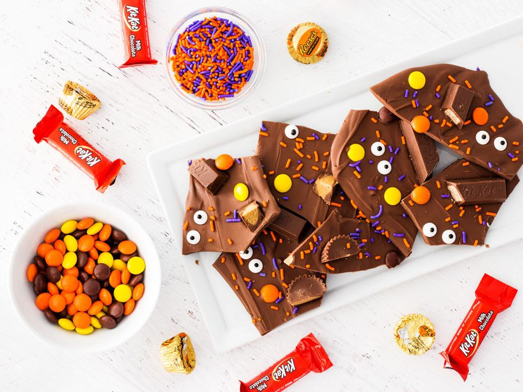 Halloween candy bark with sprinkles, candy eyes, Reese's and Kit Kats. | www.ifyougiveablondeakitchen.com