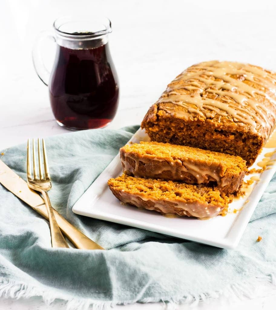 Pumpkin bread with maple glaze has cinnamon, nutmeg, ginger and cloves for ultimate pumpkin spice flavor. This recipe is the best! | www.ifyougiveablondeakitchen.com
