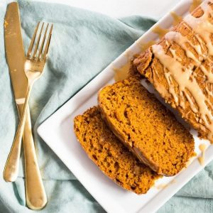 Pumpkin bread is drizzled with a maple syrup glaze for extra fall flavor. This easy recipe makes a delicious spiced pumpkin bread for fall. | www.ifyougiveablondeakitchen.com