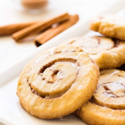 Cinnamon roll cookies are buttery, flakey and layered with cinnamon sugar goodness. This recipe is perfect for the holidays or when you're craving a sweet treat! | www.ifyougiveablondeakitchen.com