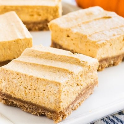 No bake pumpkin cheesecake bars are the best dessert for fall. The buttery graham cracker crust pairs perfectly with the pumpkin spice flavors! | www.ifyougiveablondeakitchen.com