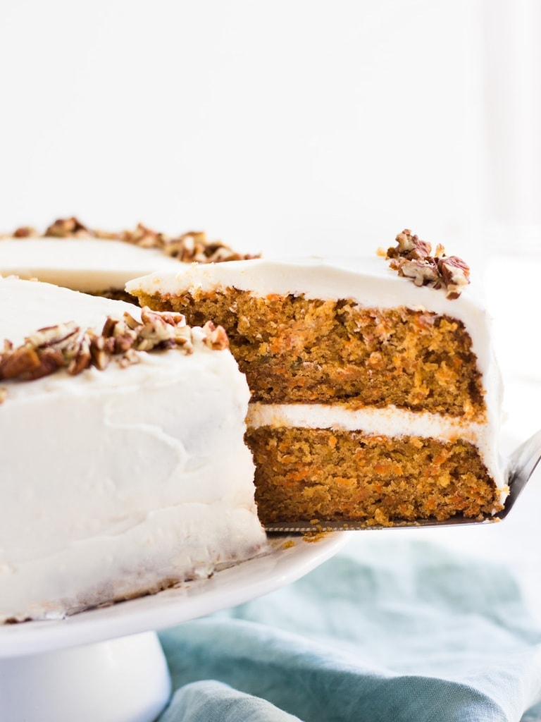 Homemade carrot cake recipe slice being served