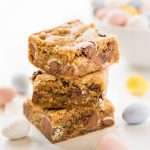 Mini egg Easter blondies stack with pastel Cadbury eggs